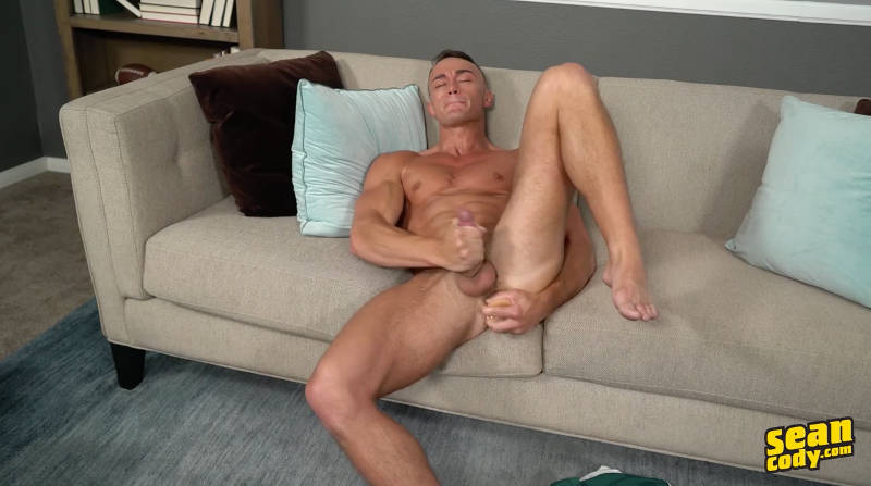 straight naked jock on a couch jerking off with a dildo in his ass