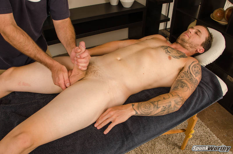 straight jock being jerked off by another man on a massage table