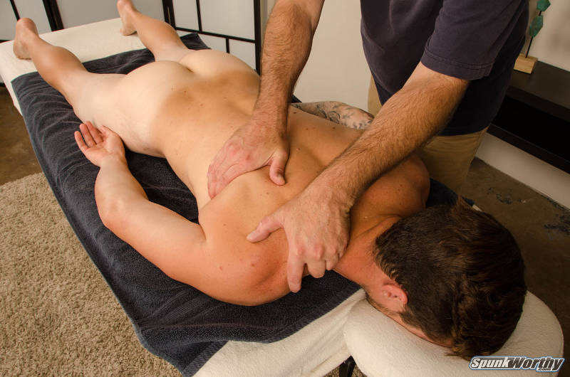 straight jock being massaged by another man