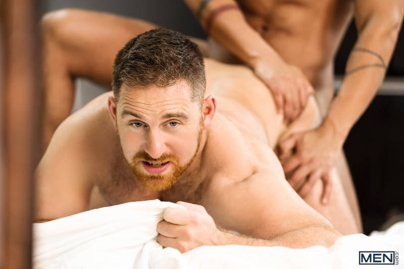 bearded hunk bent over being fucked from behind